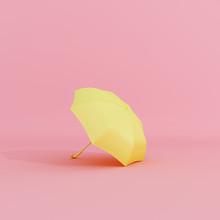 Yellow Umbrella On Pastel Pink Background Minimal Concept. 3d