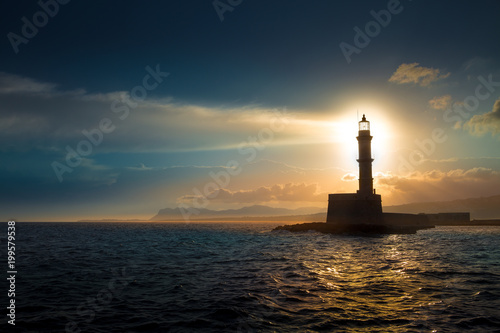 In de dag Kust A beautiful night sky behind a shining lighthouse. Chania, Crete, Greece