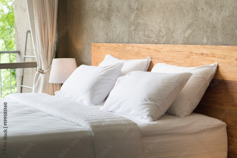 Fototapety, obrazy: White pillows on the bed in loft style bedroom.
