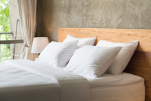 White Pillows On The Bed In Lo...