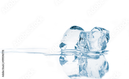 Ice cubes on mirroring reflective surface.