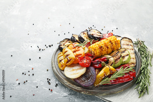 Door stickers Grill / Barbecue Grilled vegetable on brown cutting board with rosemary