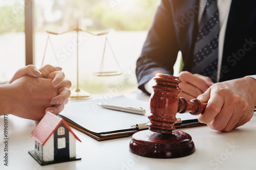 Photo  Home and land lawsuit concept, Lawyers hold a gavel to judge law and land to client