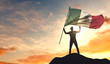 Mexico flag being waved by a man celebrating success at the top of a mountain. 3D Rendering