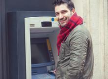 Content Man Using ATM Machine ...