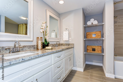 Elegant bathroom with long white vanity cabinet Fototapeta