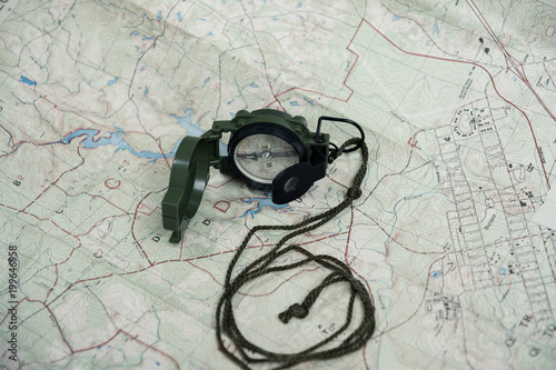 Photo  compass and map reading survival outdoors