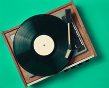 Retro Vinyl Player On A Blue Background. Entertainment 70s. Listen To Music. Top View.