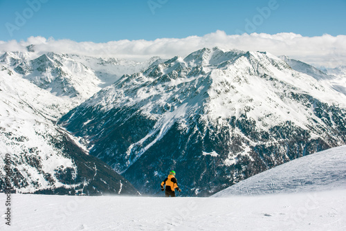 Mountain landscape and man. The skier starts the descent from the mountain