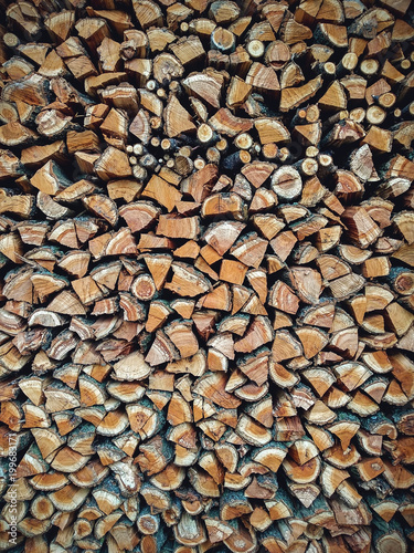 Copy spase. Texture. Different types of firewood in the stack