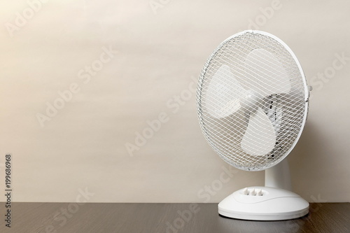 white desk oscillating fan, toned, copy space - 199686968
