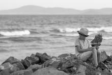 The Boy Sits On A Stony Seasho...