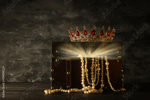 Image of mysterious opened old wooden treasure chest with light and queen/king crown with red Rubies stones Fototapete