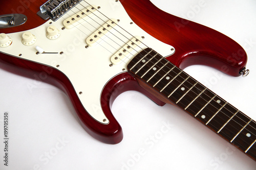 Photo  red electric guitar with a white deco