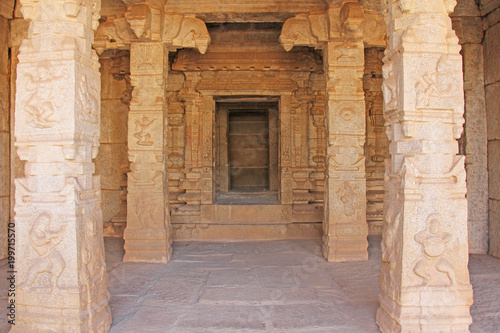 Decorative pillars from granite in mandappa or Hall. Hazara Rama Temple Hampi, Karnataka. Stone carving ancient. Indian God bas-relief. Carved columns with a pattern of stone