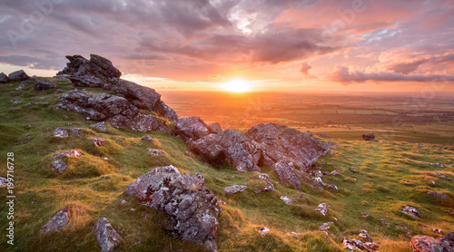 Vivid sunset fron Sourton tor Dartmoor national park Devon uk