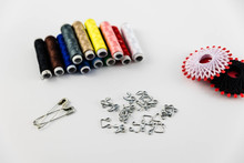 Tool Kit For Sewing And Production Of Scrappy Blankets, Quilt And Fabric On A White Background  Top View, Flat Lay.