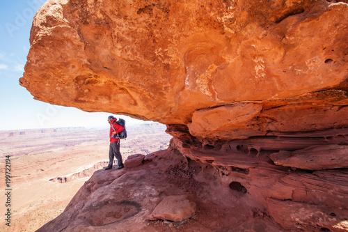 Foto op Canvas Baksteen Hiker in Canyonlands National park in Utah, USA