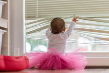 Cute Little Baby Girl Wearing A Pink Tutu