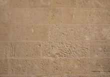 Traditional Weathered Stone Wall Background In Malta