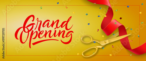 Foto Grand opening festive banner design with frame, confetti and gold scissors cutting red ribbon on yellow background