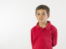 Serious Little Boy In Red Shir...