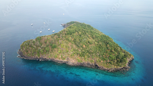 Aerial photo tropical island and ocean with yachts in Thailand