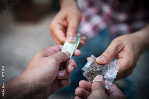 Valokuva  Drug addict buying narcotics and paying