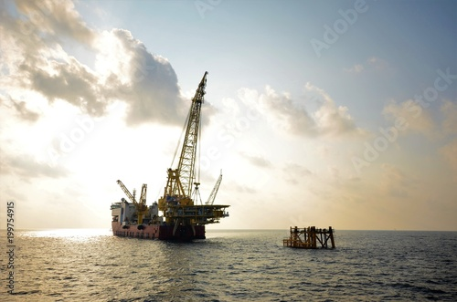 Valokuva  Derrick lay vessel is lifting platform topside to install on existing jacket