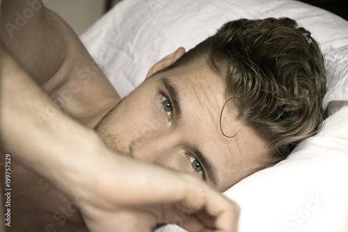 Fotografie, Obraz  Handsome, sexy good looking man with green eyes first thing in the morning, look