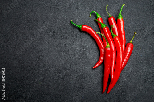 Staande foto Hot chili peppers red chili pepper on dark concrete background
