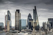 London cityscape skyline with iconic landmark buildings in The City with moody stormy sky