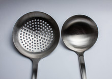 Close-up Of Two Cooking Spoons...