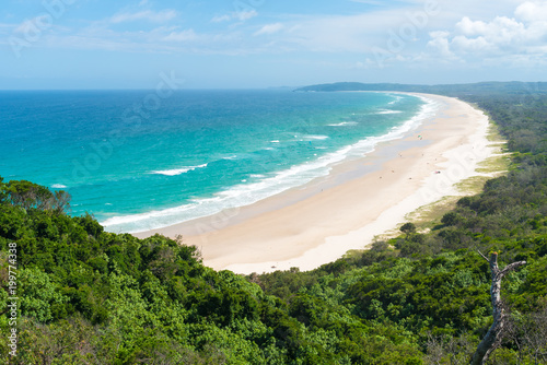 Leinwand Poster View over Tallow Beach with turquoise waters in Arakwai National Park at Byron Bay, NSW, Australia