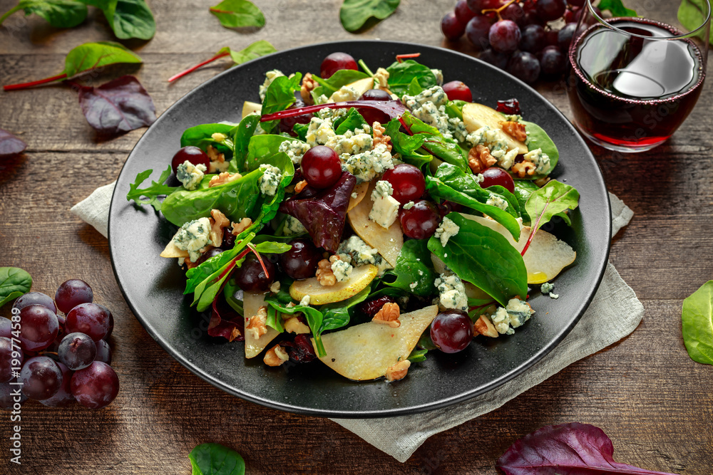 Fototapeta Fresh Pears, Blue Cheese salad with vegetable green mix, Walnuts, red grapes. healthy food
