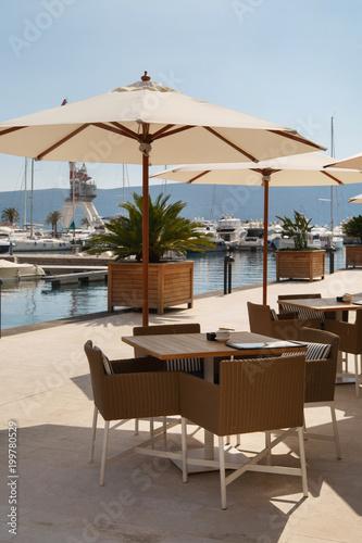 Photo sur Toile Drawn Street cafe Street cafe on the sea promenade, Montenegro, Tivat.