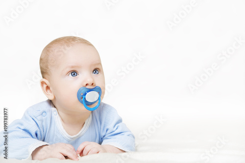 Fotografia, Obraz  Baby Sucking Pacifier, Infant Kid Boy Raising Up Head and Suck Soother Dummy, Ch