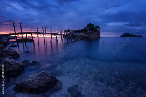 Staande foto Eiland View from Agios Sostis and Cameo island with wooden bridge shot before sunrise . Zakynthos Greece.