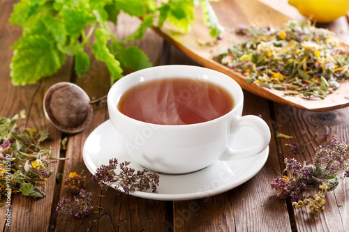 Deurstickers Thee Cup of herbal tea with various herbs