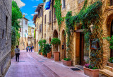 Fototapeta Uliczki - Old street in San Gimignano, Tuscany, Italy. San Gimignano is typical Tuscan medieval town in Italy