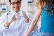 Patient visitng doctor for annual flu shot inoculation for preve
