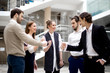 Business people show rock, paper and scissors at outdoors