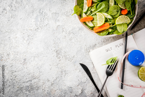 Diet plan weight lose concept, fresh vegetable salad with fork, knife, note pad, Canvas Print