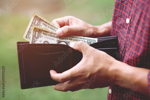 Fotografía Business Person holding an wallet in the hands of an man no money have a little money