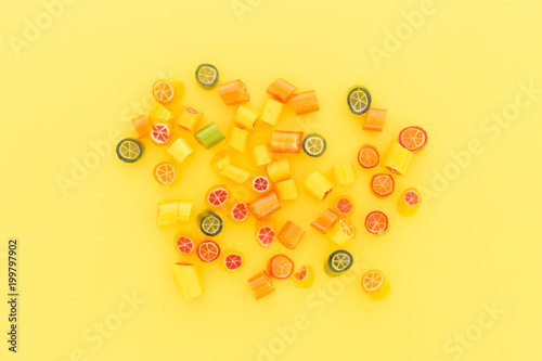 Poster  Assortment of colorful sweet handmade candy pieces arranged on yellow paper