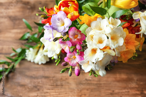 Canvas Prints Floral Beautiful bouquet of freesia flowers on table, closeup