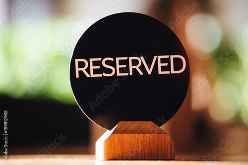 booking and reservation concept round plate with written word