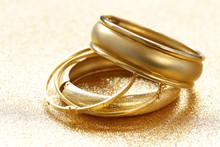 Gold Jewelry Bracelets On Gold Background
