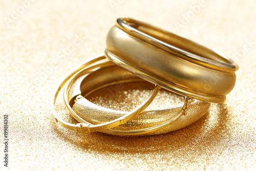gold jewelry bracelets on g...