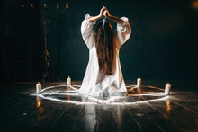 Woman With Knife Sitting In Pentagram Circle